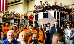 Michigan voters listen to Hillary Clinton's economic speech at Futuramic Tool & Engineering in Detroit last Thursday.