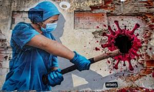 A street art mural entitled 'Angels On Earth', depicts nurse Sofia hitting the coronavirus with a baseball bat on 24 February 2021 in Vila Nova de Gaia, Portugal.