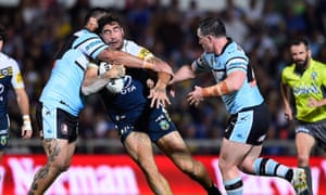 James Tamou of the Cowboys is tackled.