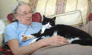 An older woman with a cat.