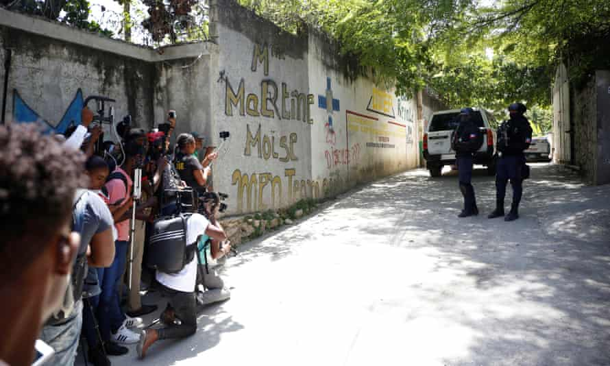 Gunmen assassinate Haitian president at his home, in Port-au-PrinceJournalists gather next to police officers standing guard near the private residence of Haiti's President Jovenel Moise after he was shot dead by gunmen with assault rifles, in Port-au-Prince, Haiti July 7, 2021. REUTERS/Estailove St-Val NO RESALES. NO ARCHIVES