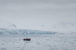 Greenpeace activists drive their Rhib near Dahlbreen glacier in Svalbard.