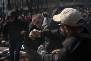 Nationalists fight with pro-Russian supporters at the Soviet-era monument to Gen Nikolai Vatutin in Kiev