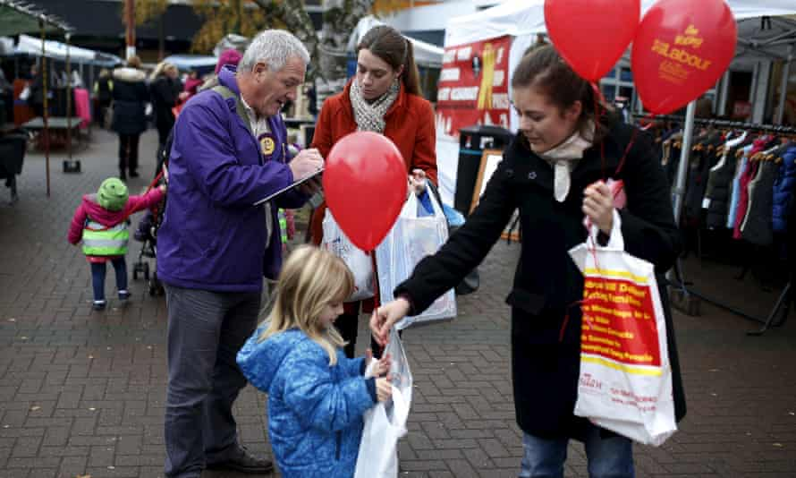 Labour and Ukip supporters canvass for votes at Royton Market near Oldham.