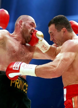 Klitschko slams a right hook into Fury's face