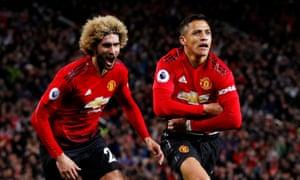 Alexis Sánchez, right, celebrates scoring Manchester United's third goal against Newcastle United together with Marouane Fellaini.
