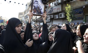 Families of victims of the terrorist attack in Ahvaz attend a mass funeral in September 2018.