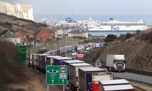 Lorries queue to enter the port of Dover as French customs officers carry out industrial action to protest about pay and to show the effect Brexit will have on cross-Channel passengers