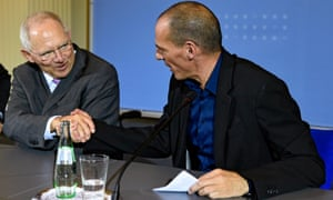 German Finance Minister Wolfgang Schaeuble, left, and the Finance Minister of Greece, Yanis Varoufakis, right, shake hands after their press conference.