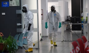 Members of the Spanish Military Emergencies Unit wearing protective gear prepare to disinfect the Lope de Vega Cultural Center in the Vallecas neighbourhood where rapid antigen test for Covid-19 were conducted to residents of the area, on 30 September 2020 in Madrid.