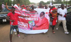 Supporters of Sierra Leone presidential candidate Samura Kamara, the foreign affairs minister, celebrate his selection by Ernest Bai Koroma in the streets of Makeni