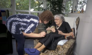 A carer and elderly woman in a residential care home