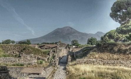 Pompeii with Mount Vesuvius looming over it.