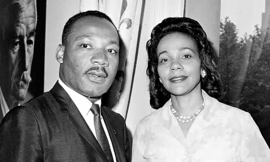 Dr.Martin Luther King and his wife, Coretta, wait to board a flight to Oslo to collect his peace prize in 1964.