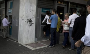 People line up at an ATM outside a branch of the National Bank, in central Athens, on Friday, June 19, 2015. Greece failed to secure a deal with bailout creditors on Friday, prompting the European Union to calls an emergency leaders' meeting for Monday. (AP Photo/Petros Giannakouris)