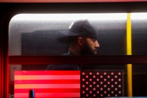 """A man who has been detained is seen on a bus as protesters attend an """"I can't breathe"""" vigil and rally in the Brooklyn borough of New York City, U.S., following the death of African-American George Floyd who was seen in graphic video footage gasping for breath as a white officer knelt on his neck in Minneapolis, Minnesota, May 29, 2020."""