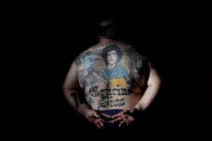 Buenos Aires, ArgentinaGuillermo Rodriguez, a devoted Diego Maradona fan shows off his tattoes on his back in his pizza shop called 'Siempre al 10' referring to Maradona's jersey's number