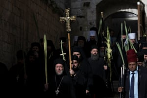 Greek Orthodox clergymen in the Palm Sunday procession at the Church of the Holy Sepulchre in the Old City of Jerusalem
