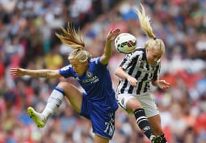 Gemma Davidson of Chelsea battles with Alex Greenwood in the air.