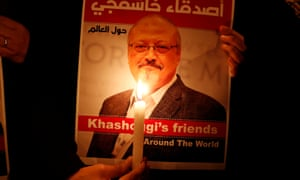 A demonstrator holds a poster with a picture of Saudi journalist Jamal Khashoggi outside the Saudi Arabia consulate in Istanbul, Turkey, on 25 October.