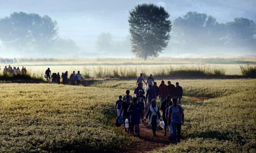 Syrian refugees in frosty field