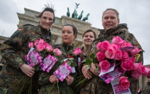 Soldiers distribute flowers in Berlin, Germany