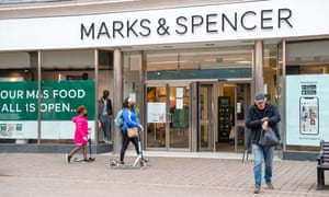 Shoppers outside an M&S store in Staines, Surrey, last month