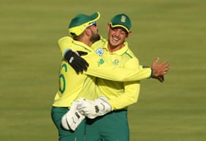 Shamsi celebrates taking the catch to dismiss Buttler.