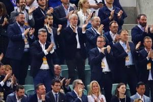 Owner of Chelsea Roman Abramovich applauds as Eden Hazard of Chelsea leaves the field.