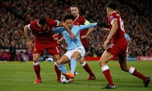 Manchester City's Leroy Sane tussles with Liverpool's Dejan Lovren.