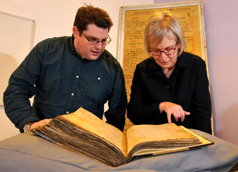 Gary Brannan and Sarah Rees Jones examine one of the archishops' registers.