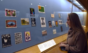 A visitor looks at postcards in a new exhibition at the British Museum.