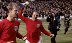 Ray Wilson and Jack Charlton celebrate England's 1966 World Cup triumph at Wembley Stadium