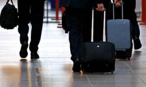 Air crew make their way through Glasgow Airport
