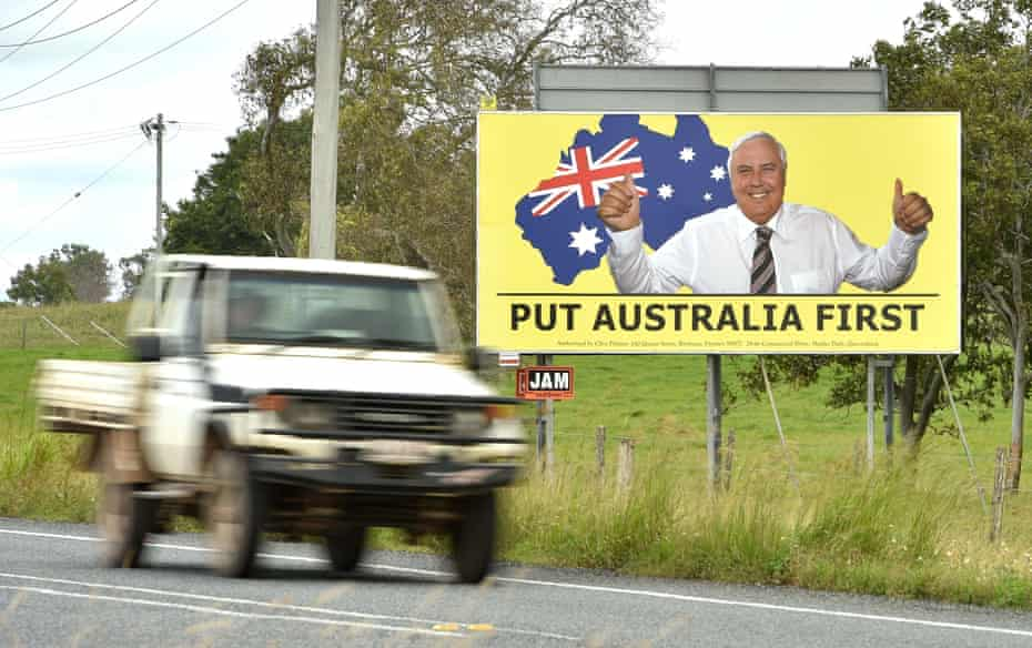 A ute driving past an election sign for mining magnate Clive Palmer's United Australia party in Bowen in northern Queensland, on 3 May 2019.