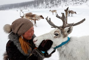 Yakutia, Russia: Svetlana Pakhomova, whose husband breeds deer, pets an animal at a deer farm in Aldansky district
