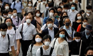 Tokyo commuters wearing masks to protect from coronavirus.