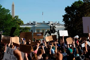 Washington Demonstrators hold up placards in a protest outside the White House on Monday