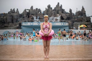 Swimmer Ri Song-Hui poses for a portrait at the Munsu Water Park in Pyongyang on 21 July