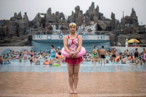 A young swimmer poses for a portrait at the Munsu water park in Pyongyang, North Korea