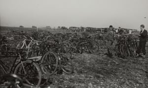 Bicycles belonging to white children parked at an airshow.