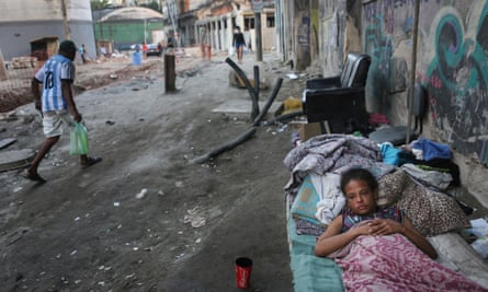 Vanessa, currently homeless, rests on a street where construction of a new Light Rail System has been delayed and partially completed in the Port Zone, on June 17, 2016 in Rio de Janeiro, Brazil.