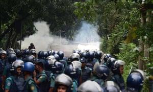 Bangladeshi police clash with students in Dhaka on Sunday.