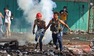 Protesters in Baghdad flee teargas canisters