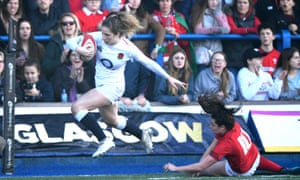 Abby Dow skips down the wing on the way to a try against Wales