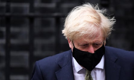 Boris Johnson leaves No 10 Downing Street for the House of Commons to make an announcement on lockdown restrictions.