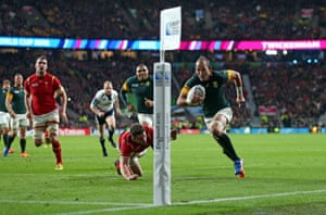 South Africa's Fourie Du Preez runs in to score the winning try against Wales.