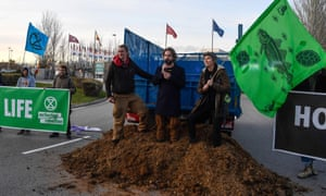 Activists dump manure outside the COP25 climate talks congress in Madrid on Saturday.