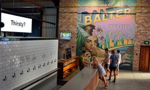 Interior view of Balter microbrewery pub in Currumbin, with people by bar counter.