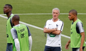 Didier Deschamps chats with Kylian Mbappé at a France training session with Paul Pogba in attendance.